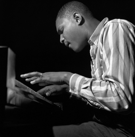 21 Aug 1961, Englewood Cliffs, New Jersey, USA --- McCoy Tyner plays piano during the recording session for Freddie Hubbard's Ready for Freddie album. --- Image by © Mosaic Images/CORBIS
